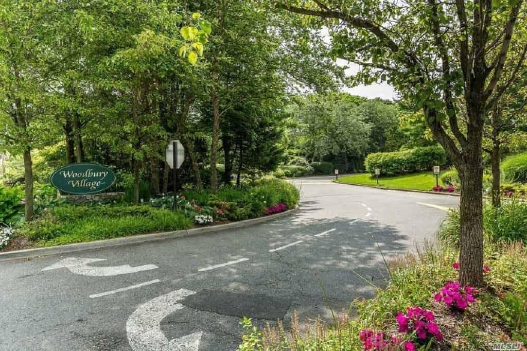 Samuel Realty Group | 13 Pond Path, Woodbury, NY 11797