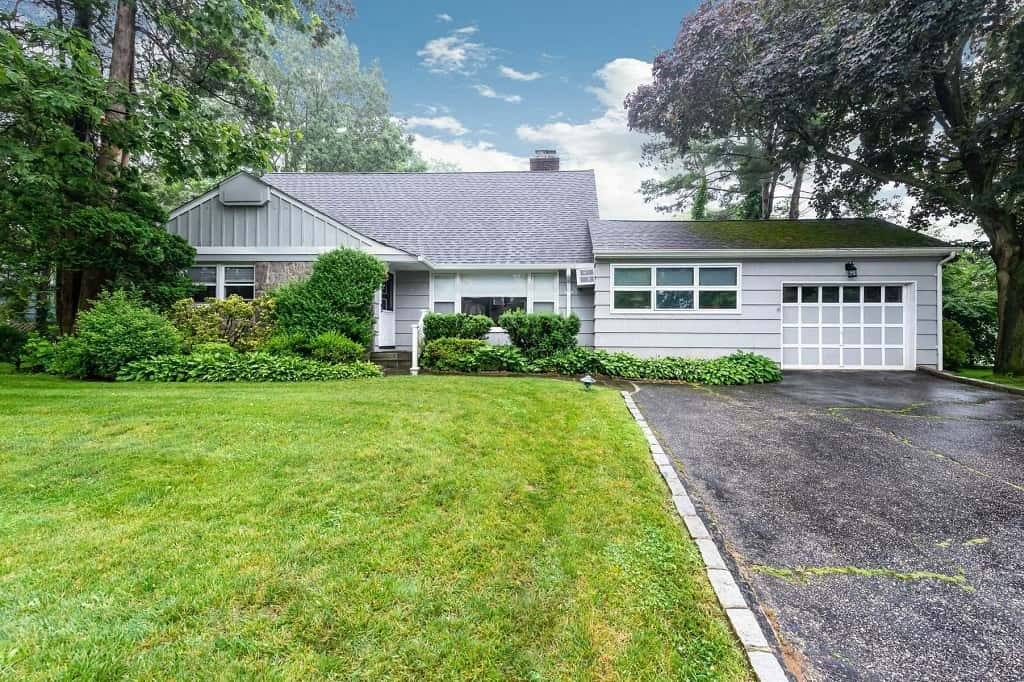 Samuel Realty Group | 11 Overlook Terrace, East Hills, NY 11577